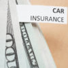 Paper with words car insurance and money. Insurance concept