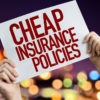 Cheap Insurance Policies placard with night lights on background