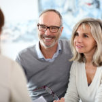 Senior couple meeting agent for insurance